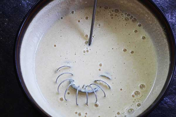tahini dressing mixture in mixing bowl.