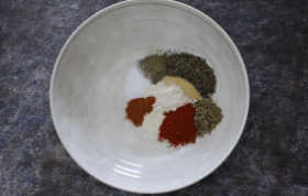 all of the different seasonings in a white bowl.