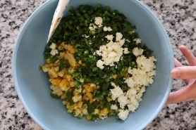All of the mexican street corn ingredients in a mixing bowl.