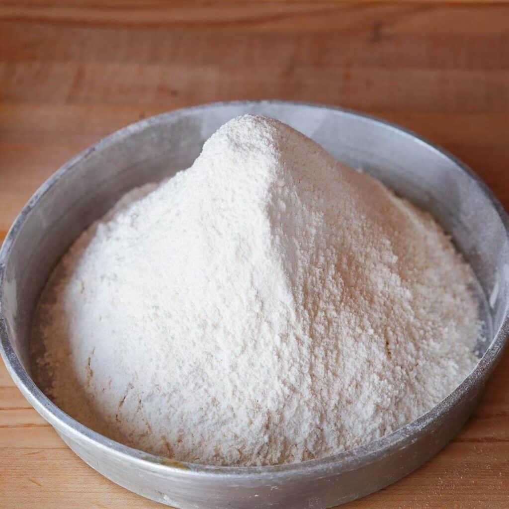 sifted flour in an aluminum pan.
